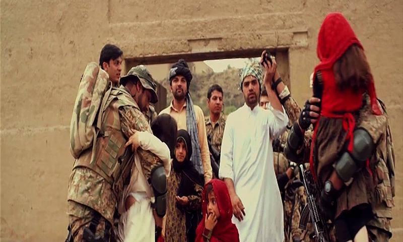 Soldiers exit battleground carrying children. ─ ISPR