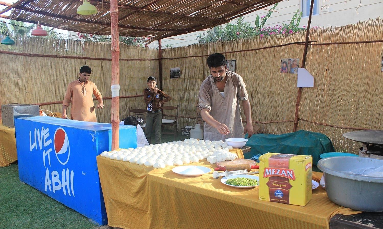 A man prepares the parathas. — Photo by Manal Khan