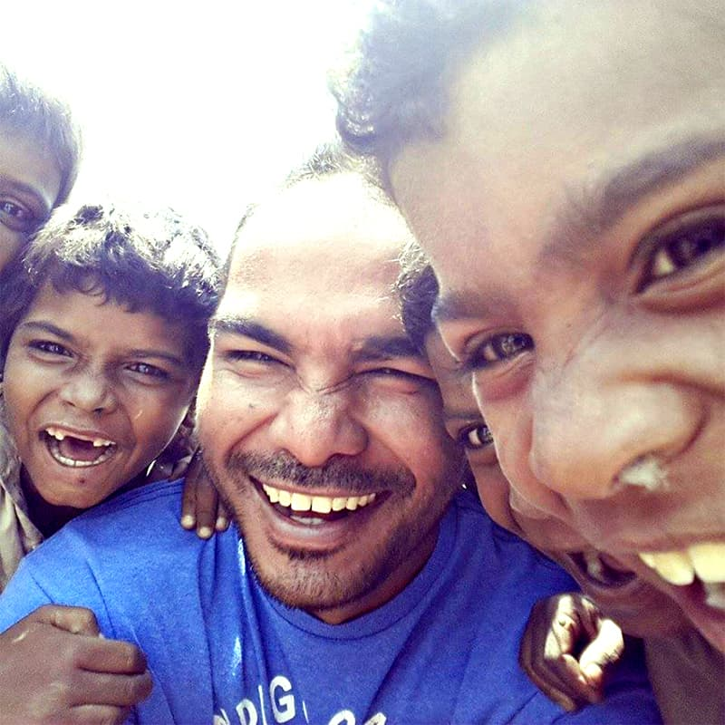 Sabir poses with a group of boys from his neighbourhood.