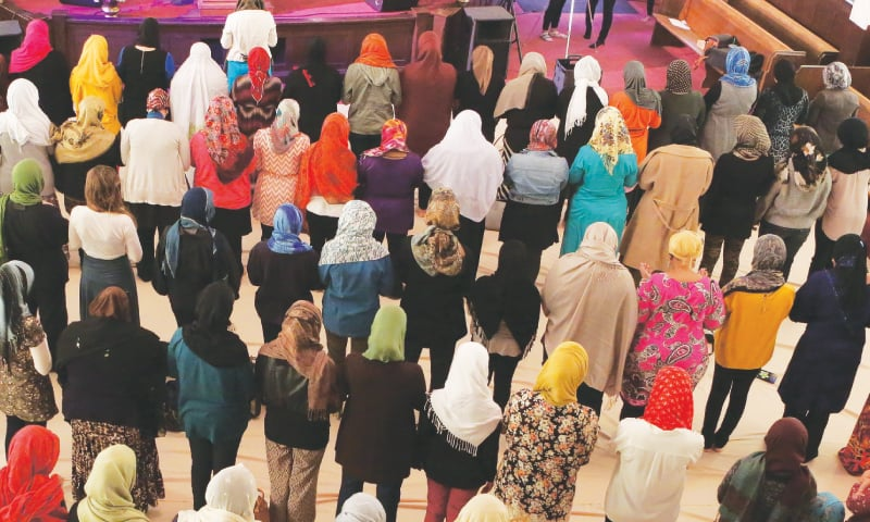 Photo taken with special permission shows prayers under way at the women-only mosque housed in the oldest synagogue in Los Angeles, United States.