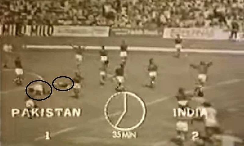 Two Sikh players performing the sajda at the end of the Pakistan-India final of the 1975 Hockey World Cup.