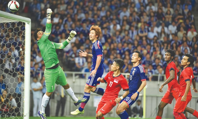 SAITAMA (Japan): Singapore's goalkeeper Mohamad Izwan Bin Mahbud punches the ball away from the goalpost during the 2018 World Cup qualifier against Japan on Tuesday.—AFP