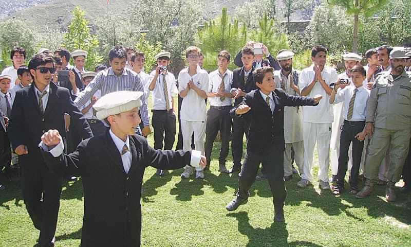 Students of the Langland School and College greet the visiting team from England by performing a Chitrali dance
