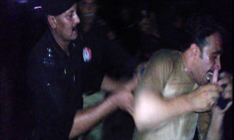 A policeman arrests a protester during violent demonstratioins against load shedding.—Ali Akbar