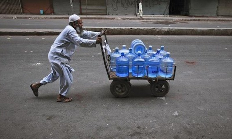 Bottled water is consumed by a very small percentage of people in urban areas who can afford to do so; the rest of the population uses groundwater. ─ Reuters/File