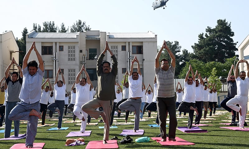 Afghans and foreigners perform yoga during the first International Yoga Day, at the Indian Embassy in Kabul, Afghanistan. ─ AP