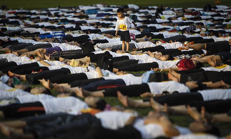 A Malaysian boy is seen playing during the International Day of Yoga festival in Kuala Lumpur, Malaysia. ─ AP