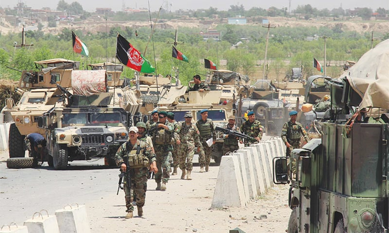 Afghan troops deploy near Chardarah district in Kunduz province on Sunday as they prepare for battle with Taliban militants.—AFP