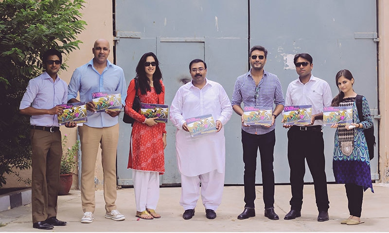 Imran Azhar with actor Adnan Siddiqui, SP Ghulam Murtaza, WWF Corporate Relations Manager Asad Shahbaz Khan and other attendees. — Publicity photo