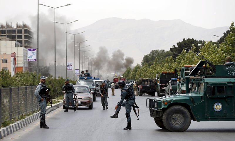 Smoke rises from the site of an attack near the Afghan parliament. ─ Reuters