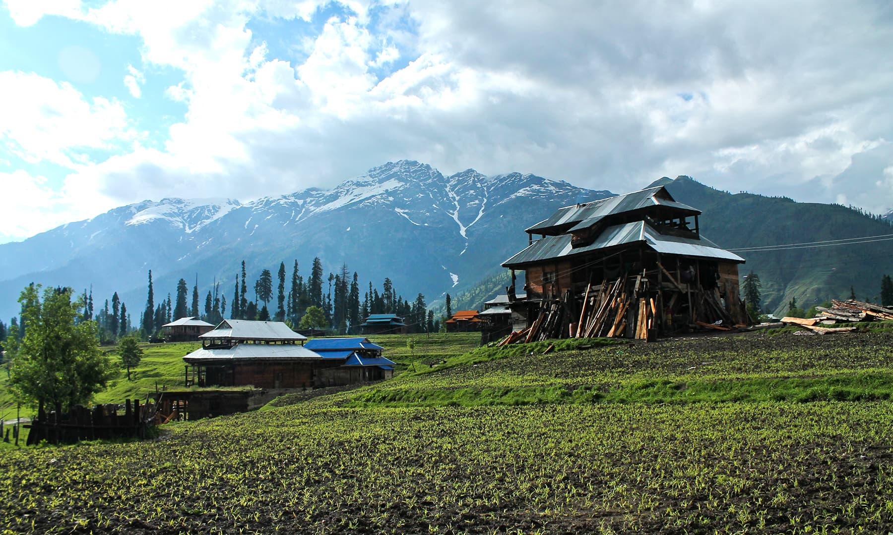 Farmland, houses and mountains. —Asif Mahmood