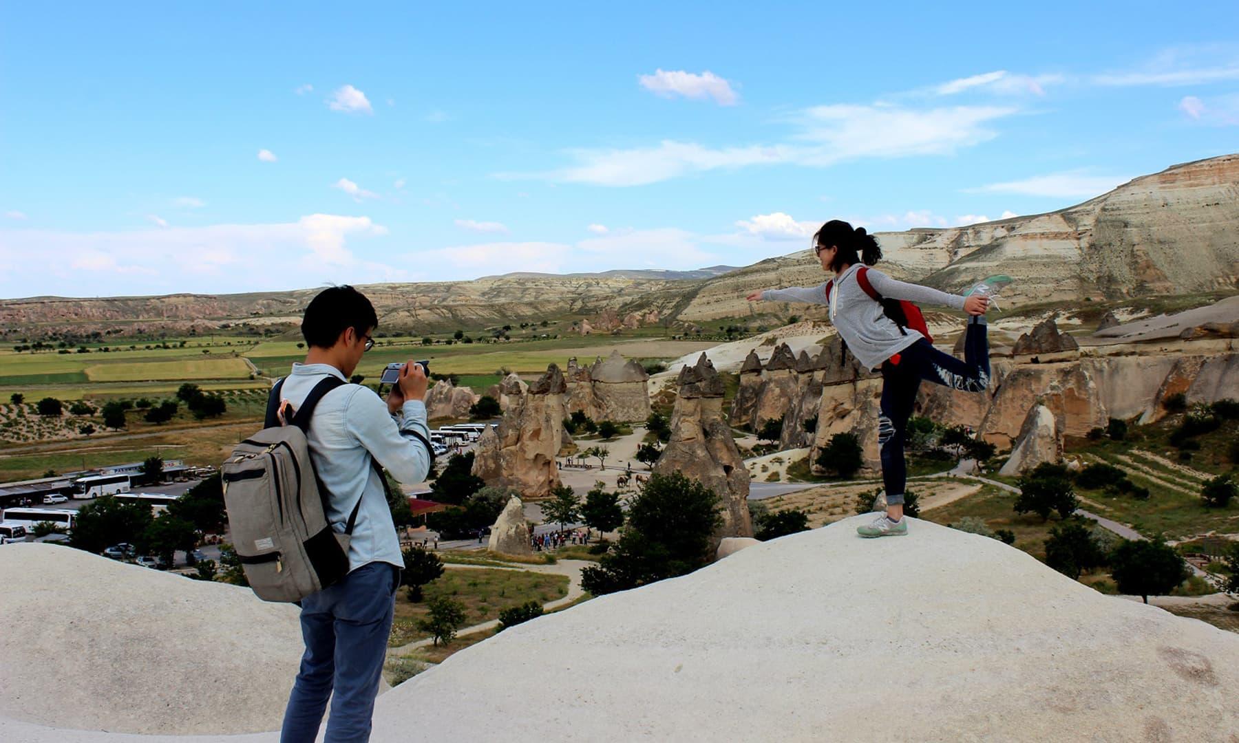 Tourists enjoying the backdrop.