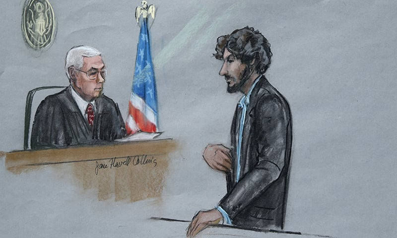 In this courtroom sketch, Boston Marathon bomber Dzhokhar Tsarnaev, right, stands before U.S. District Judge George O'Toole Jr. as he addresses the court during his sentencing, Wednesday, June 24, 2015, in federal court in Boston. —AP