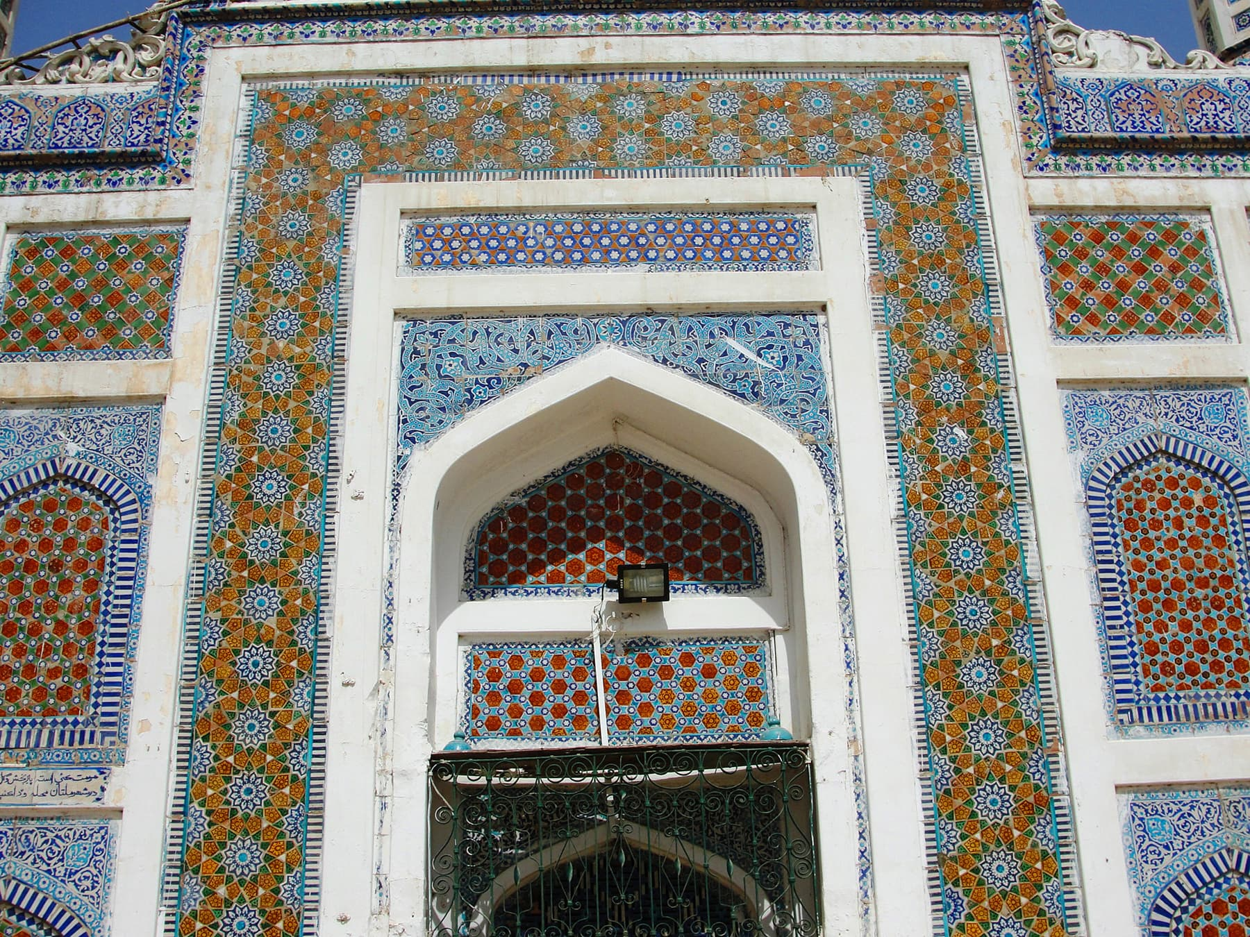 The facade of Shaikh Birkhio's tomb, covered with glazed tiles.
