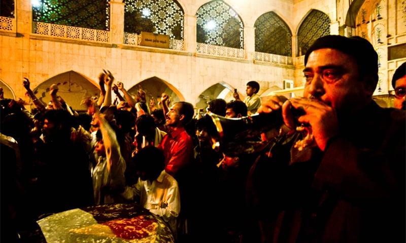 Devotees at the mausoleum of Lal Shahbaz Qalandar in Sehwan Sharif, Sindh, listening to qawwali   Syed Haseeb Amjad
