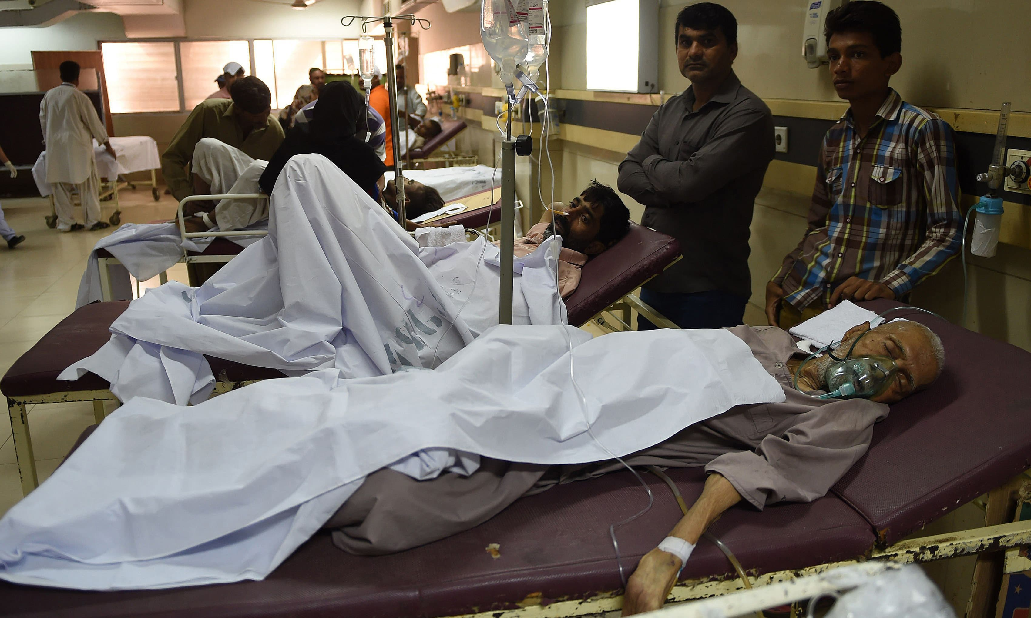 Heatstroke victims are treated at a government hospital in Karachi. — AFP