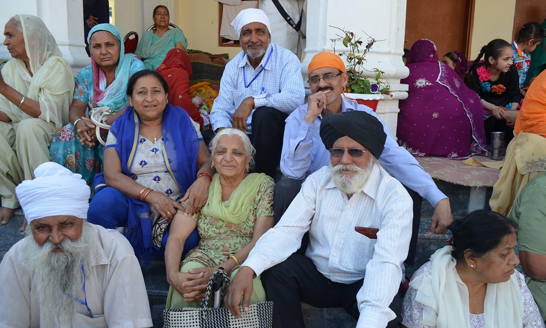 Karanveer Singh (R) with other pilgrims.