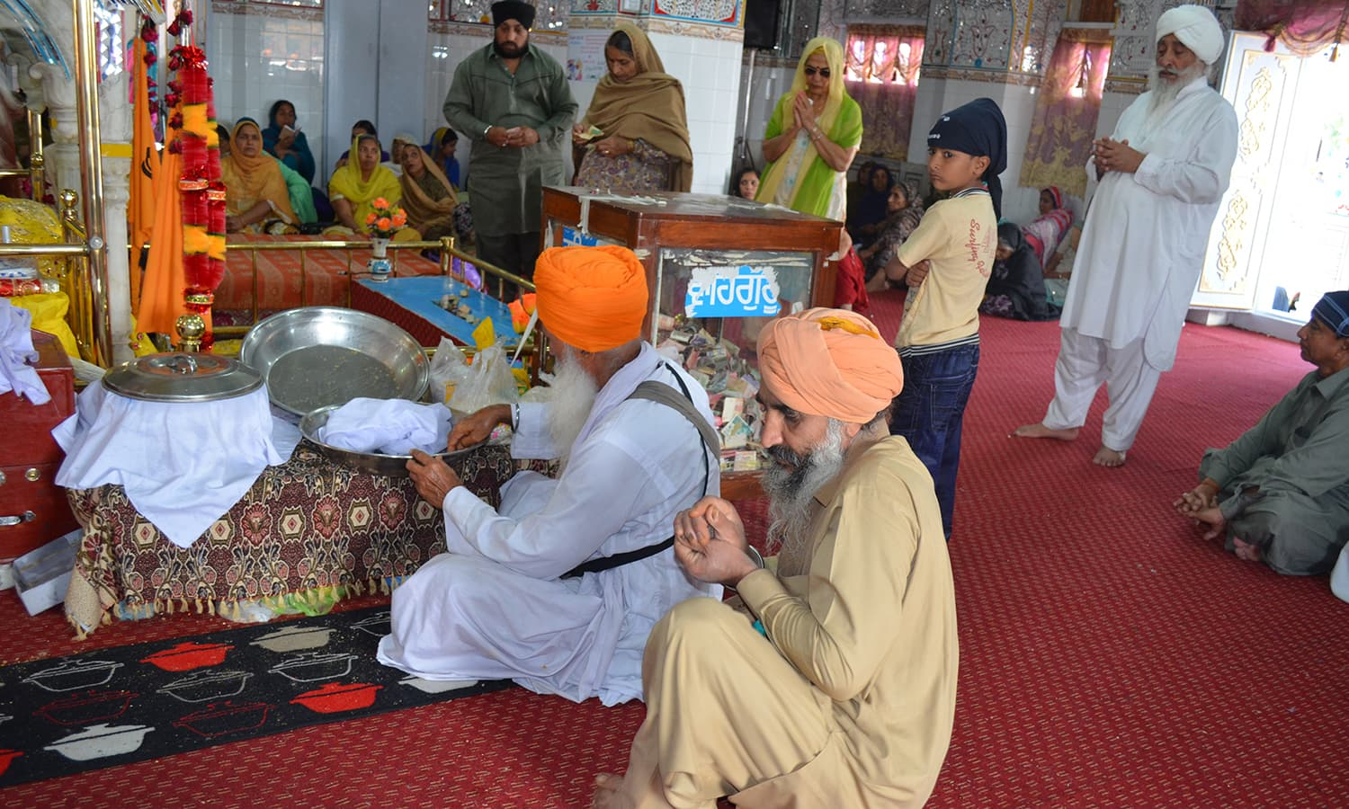 'Parshad' is distributed amongst the pilgrims.
