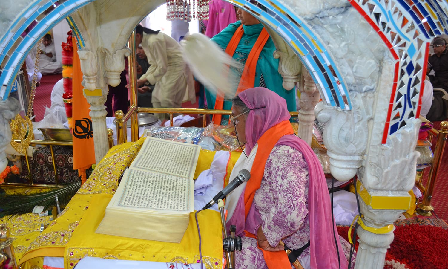 A woman reads 'Guru Granth Sahib', the holy book of the Sikh religion.
