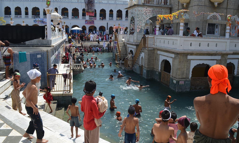 Pilgrims bathe in holy water.