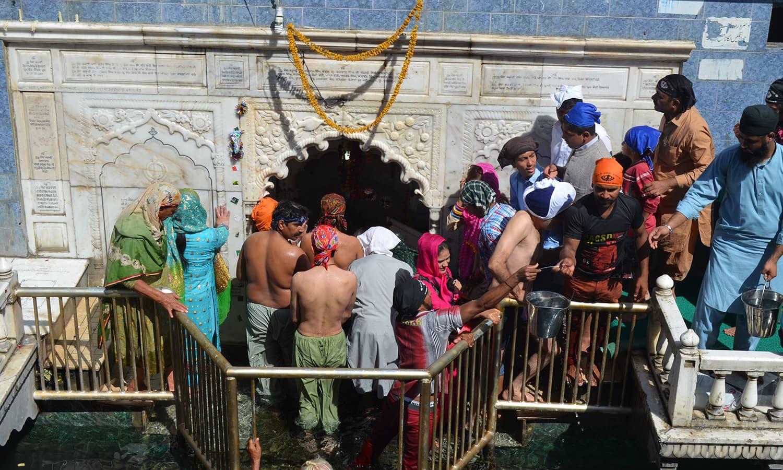 Pilgrims flock around the symbolic Punja.