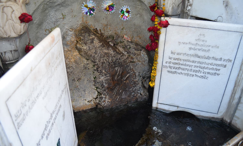 The Punja [hand print] of Baba Guru Nanak.