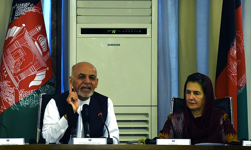 Afghan President Ashraf Ghani speaks as his wife first Lady Rula Ghani listens during a gathering of diplomats and women rights activists at The Ministry of Foreign Affairs in Kabul. ─ AFP