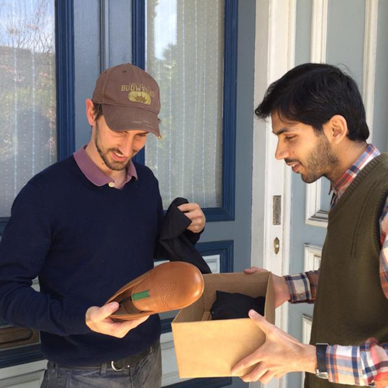 Waqas delivering shoes in the US — Publicity photo