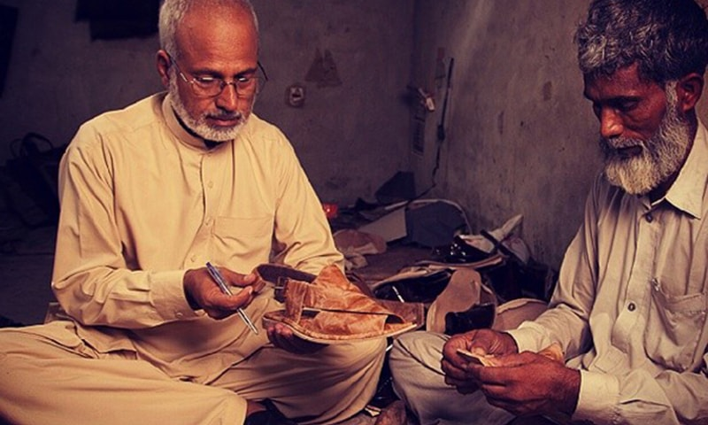 Markhor's master craftsman Muhammad Hussain making shoes from leather by hand — Publicity photo