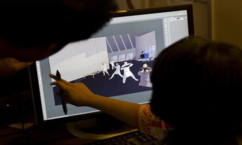 Artists work on animations for a counter extremism project in Lahore, Pakistan —  AP