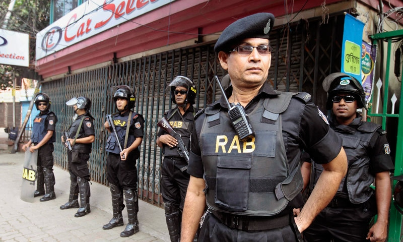 Members of Bangladesh Rapid Action Battalion (RAB) stand guard - File Photo by AP