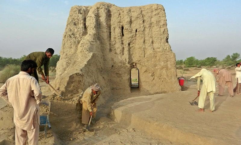 SAHIWAL: Excavation work going on at mud-brick watchtower. — Dawn