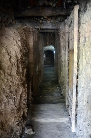 TIRAH: This narrow tunnel was used by militants to keep people detained by them.—Dawn