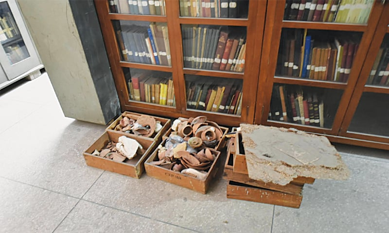 Artefacts lie uncovered in boxes at the archaeology department's exploration and excavation branch on Saturday.—White Star