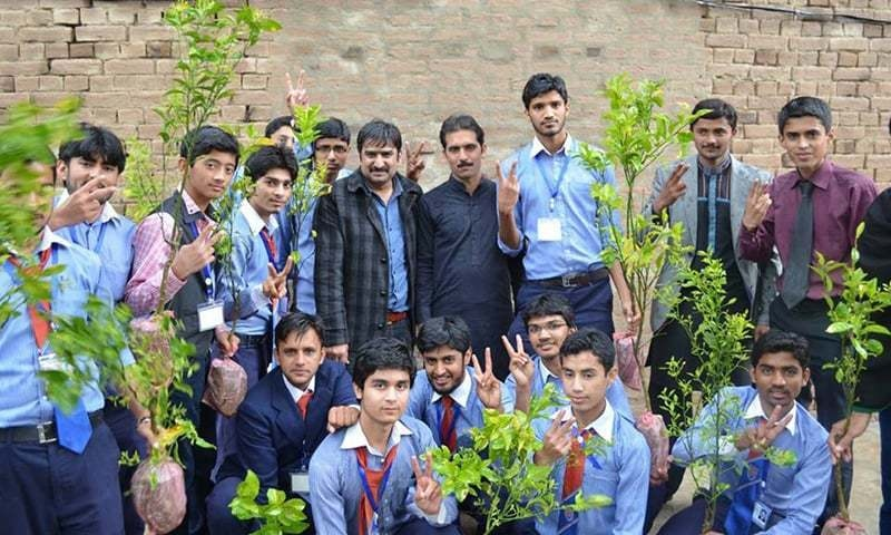 The author with school students at a plantation drive.