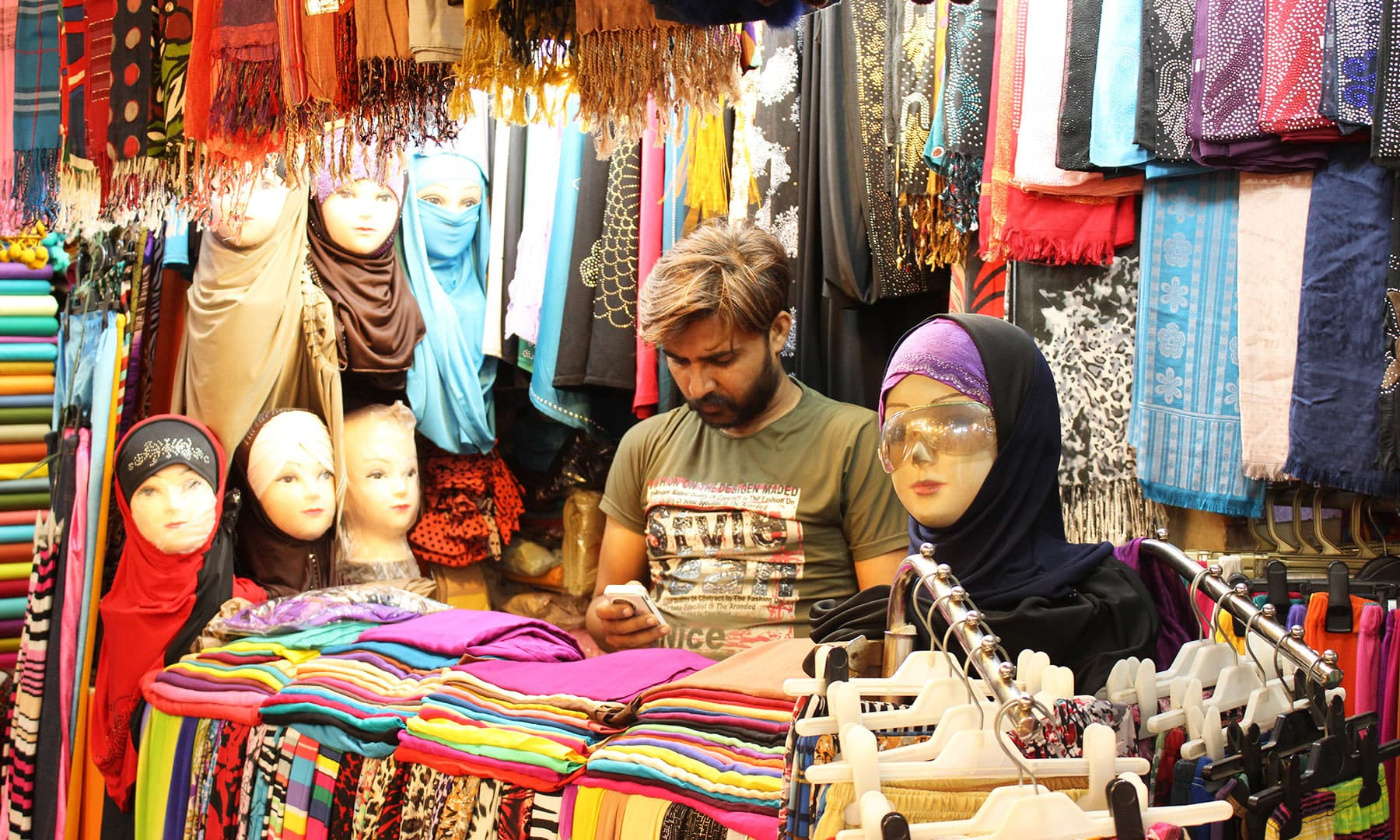 Scarves displayed on unique mannequins.