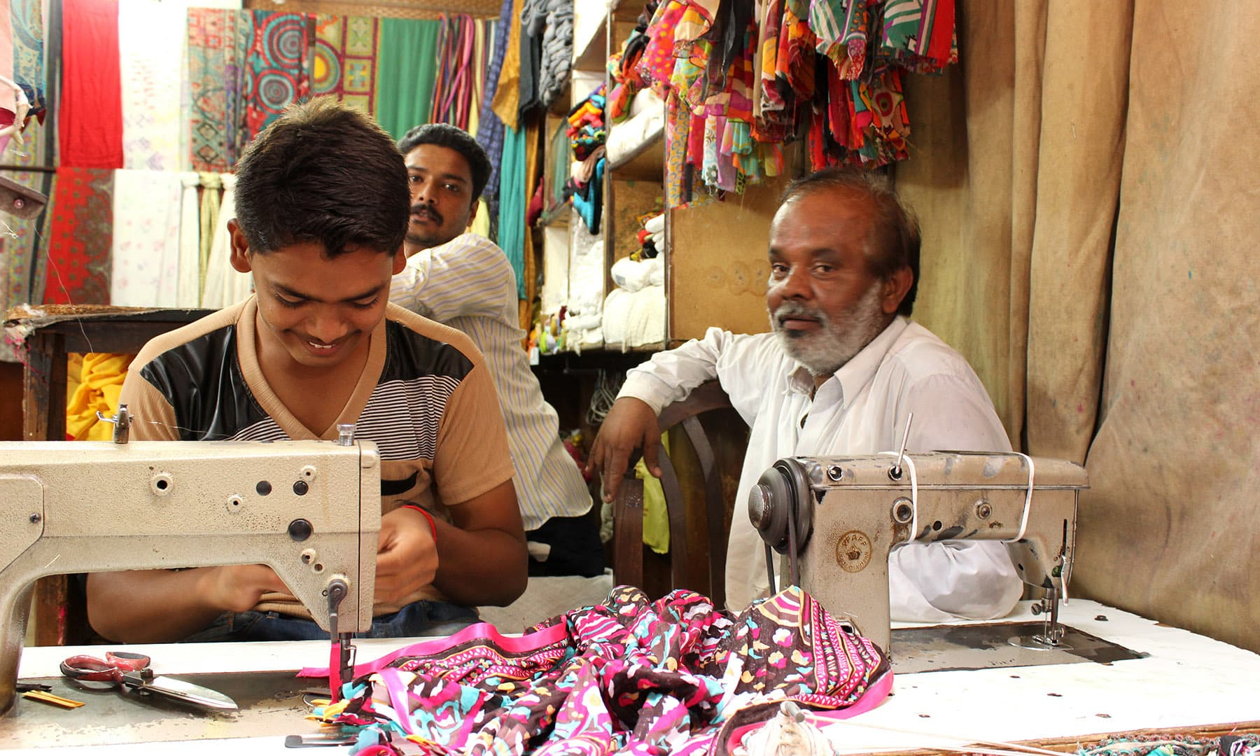 Meena Bazaar is famous for its crafty dupatta corners. This trio of son, father and grandfather have worked here since 17 years.