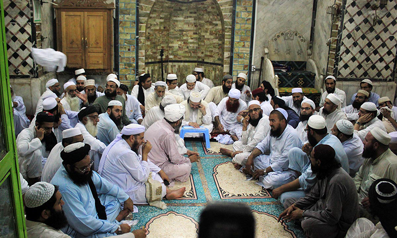 Non-governmental local Ruet-i-Hilal Committee meeting for sighting of Eid-ul-Fitr moon is presided over by  Mufti Popalzai at Qasim Ali mosque in Peshawar.  Photo by Online