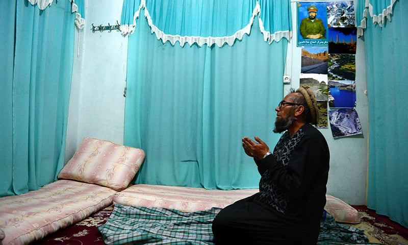 In this file photo taken on February 12, 2015, museum assistant and former Soviet soldier, Sheikh Abdullah, formally known as Bakhretdin Khakimov, prays in his home in Herat Province. – AFP/File