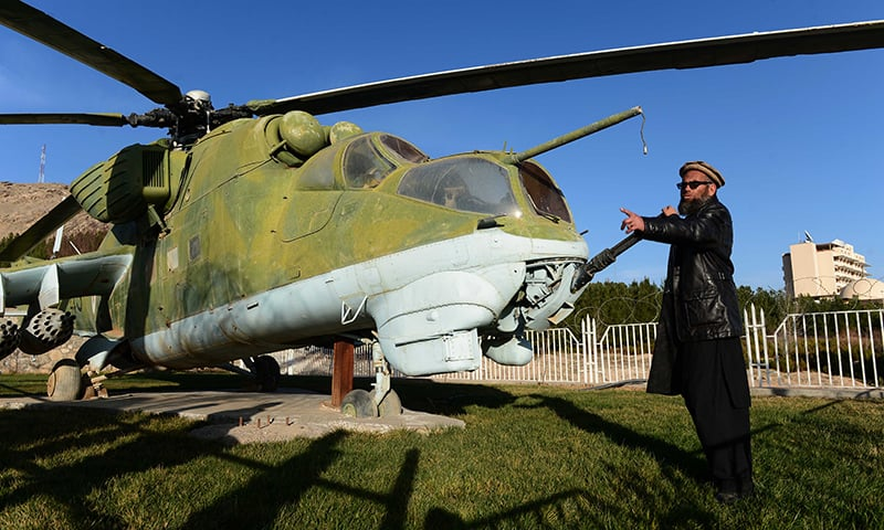In this file photo taken on February 4, 2015, Sheikh Abdullah, formally known as Bakhretdin Khakimov, stands alongside a Soviet helicopter at the Jihad Museum, which contains exhibitions about the Soviet invasion of 1979 and the Afghan resistance, in Herat Province. – AFP/File