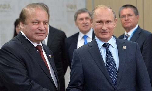 Russian President Vladimir Putin shakes hands with Pakistani Prime Minister Nawaz Sharif during the SCO summit in Ufa. —AFP