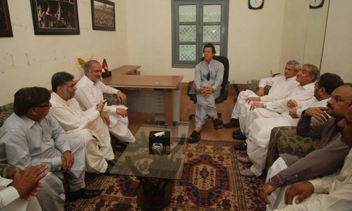Disgruntled PPP Okara leaders led by Sumsam Bokhari meet with PTI Chief Imran Khan at Bani Gala. —PTI Media Cell