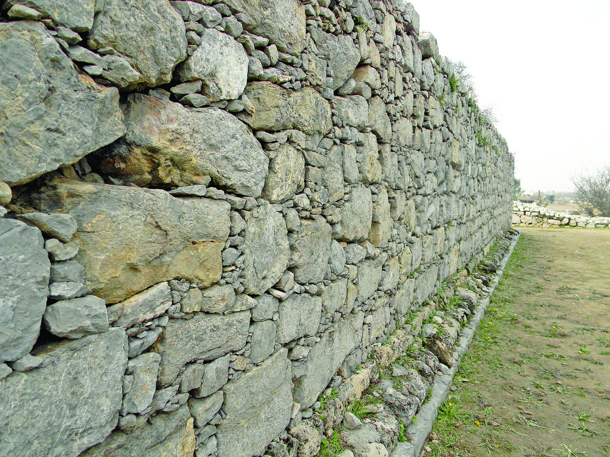 The outer wall of Jandial temple. Having been built in 1st century BC, the wall still stands tall and strong.