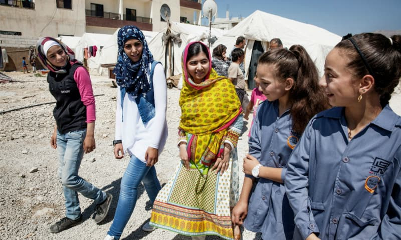 Malala Yousafzai speaks with Syrian refugee girls during her visit to Bekaa Valley, east Lebanon. ─ AP