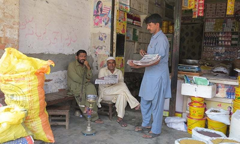 """I make Rs250 to Rs300 daily by selling newspapers at local shops and repairing shoes.""—Photo by author"