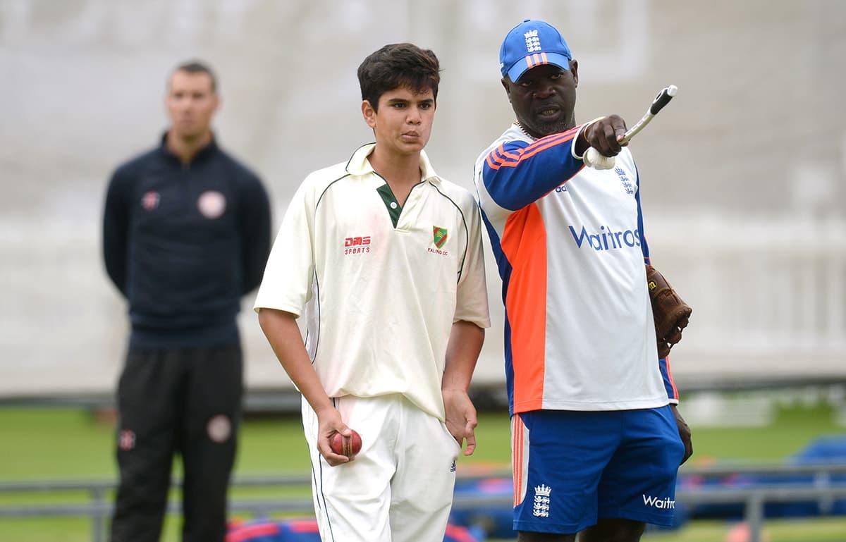 Arjun Tendulkar, son of Sachin Tendulkar with England bowling coach Ottis Gibson during nets at Lord's. — Reuters