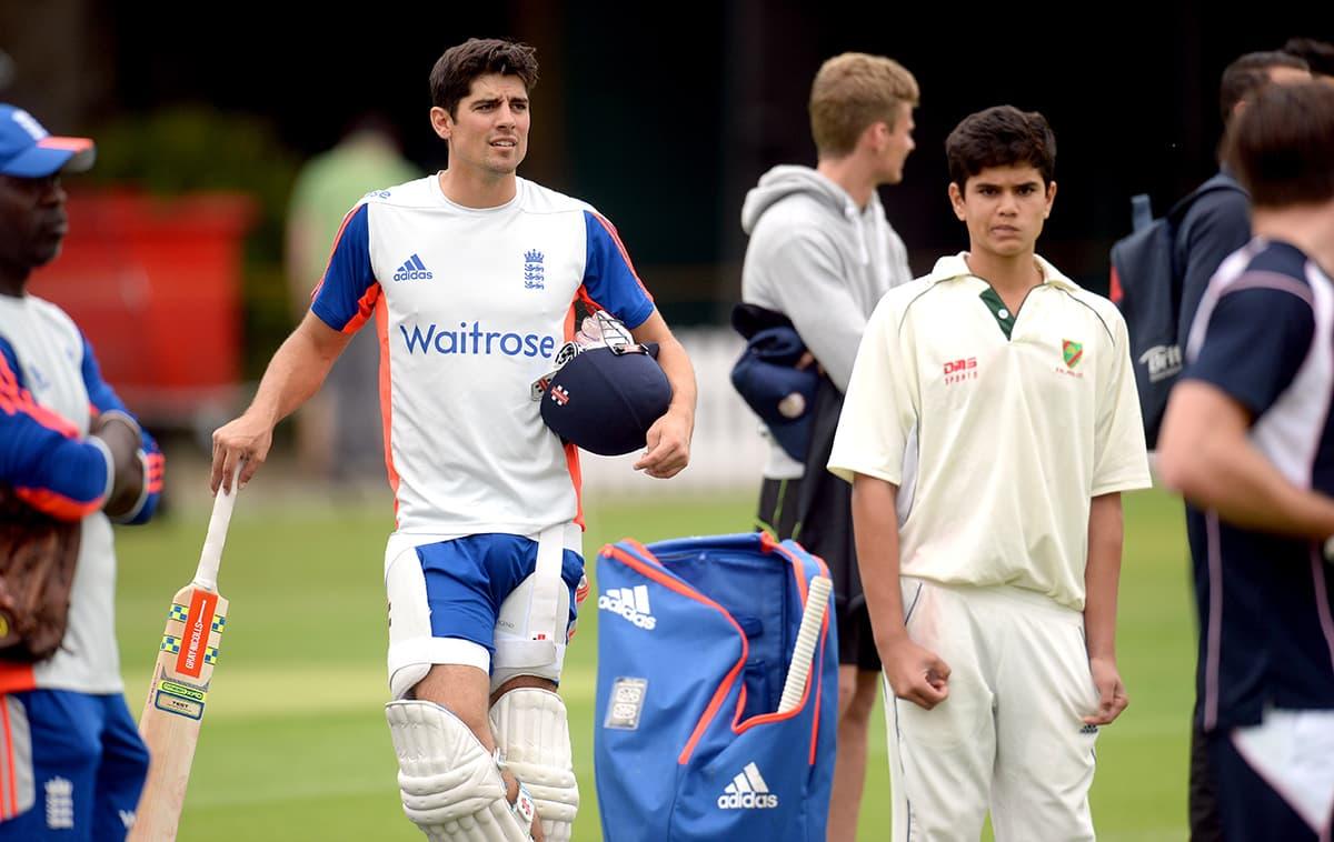 Arjun Tendulkar, son of Sachin Tendulkar and England's Alastair Cook. — Reuters