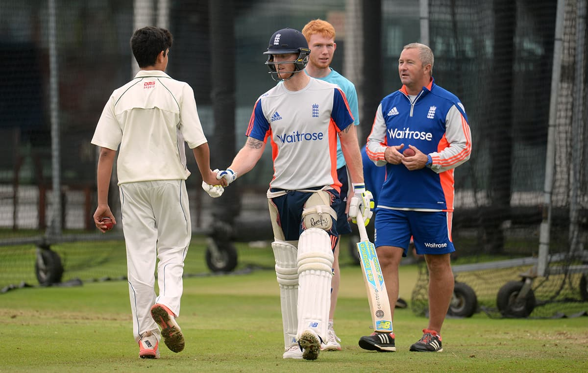 Arjun Tendulkar, son of Sachin Tendulkar shakes hands with England's Ben Stokes during nets at Lord's. — Reuters