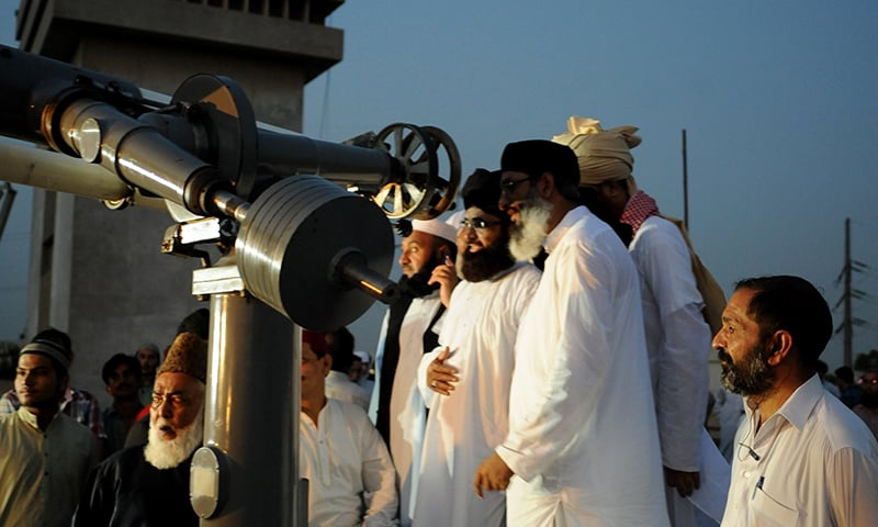 Attempting to sight the moon through an astronomical telescope | Arif Mahmood, White Star