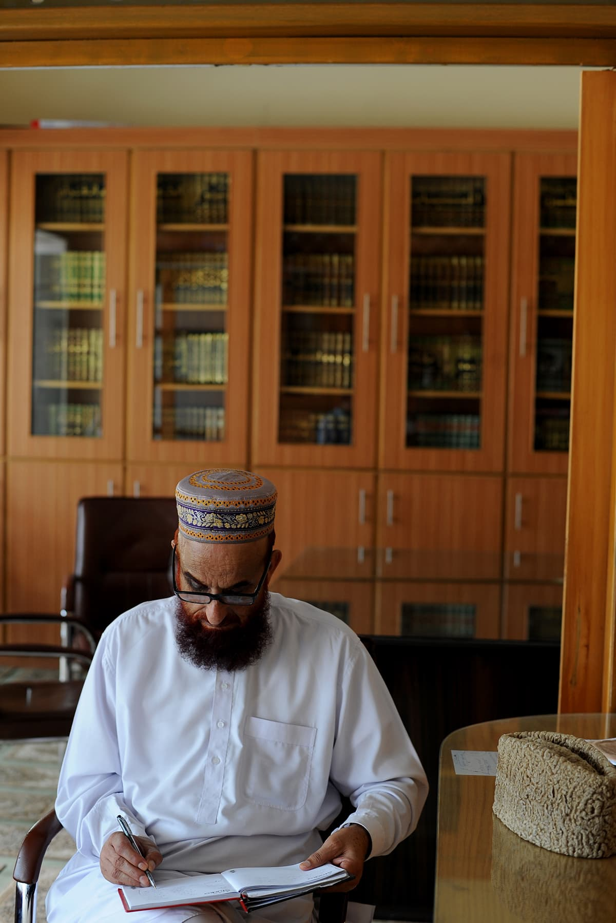 Arranged like a library of religious books, adorned only with functional furnishing, his office is a reflection of his spartan, and academic, lifestyle | Arif Mahmood, White Star